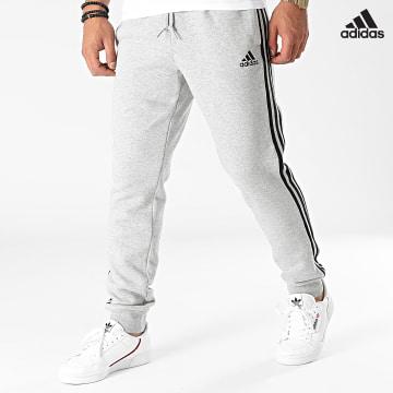 https://laboutiqueofficielle-res.cloudinary.com/image/upload/v1627638668/Desc/Watermark/adidas_performance.svg Adidas Performance - Pantalon Jogging A Bandes 3 Stripes GK8824 Gris Chiné