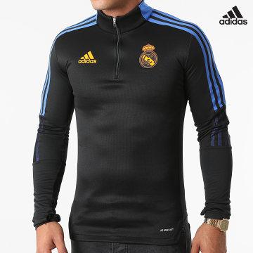 https://laboutiqueofficielle-res.cloudinary.com/image/upload/v1627638668/Desc/Watermark/adidas_performance.svg Adidas Performance - Sweat Col Zippé A Bandes Real Madrid GR4340 Noir Bleu Roi