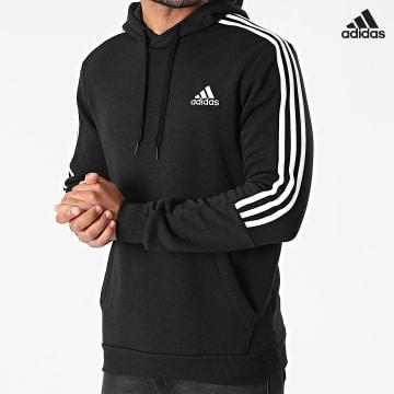 https://laboutiqueofficielle-res.cloudinary.com/image/upload/v1627638668/Desc/Watermark/adidas_performance.svg Adidas Performance - Sweat Capuche A Bandes GK9581 Noir