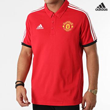 https://laboutiqueofficielle-res.cloudinary.com/image/upload/v1627638668/Desc/Watermark/adidas_performance.svg Adidas Performance - Polo Manches Courtes A Bandes Manchester United GR3898 Rouge