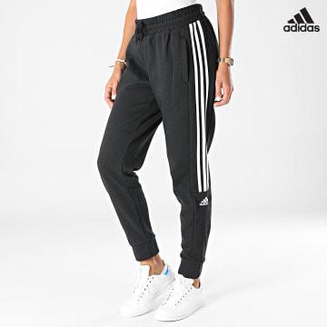 https://laboutiqueofficielle-res.cloudinary.com/image/upload/v1627638668/Desc/Watermark/adidas_performance.svg Adidas Performance - Pantalon Jogging A Bandes Femme HB2766 Noir