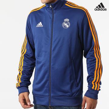 https://laboutiqueofficielle-res.cloudinary.com/image/upload/v1627638668/Desc/Watermark/adidas_performance.svg Adidas Performance - Veste De Sport Zippée A Bandes Real Madrid 3 Stripes GR4246 Bleu Marine
