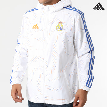 https://laboutiqueofficielle-res.cloudinary.com/image/upload/v1627638668/Desc/Watermark/adidas_performance.svg Adidas Performance - Coupe-Vent A Capuche Real Madrid GR4274 Ecru