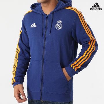 https://laboutiqueofficielle-res.cloudinary.com/image/upload/v1627638668/Desc/Watermark/adidas_performance.svg Adidas Performance - Sweat Zippé Capuche A Bandes Real Madrid 3 Stripes GR4241 Bleu Marine