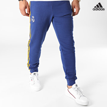 https://laboutiqueofficielle-res.cloudinary.com/image/upload/v1627638668/Desc/Watermark/adidas_performance.svg Adidas Performance - Pantalon Jogging A Bandes Real Madrid 3 Stripes GR4243 Bleu Marine