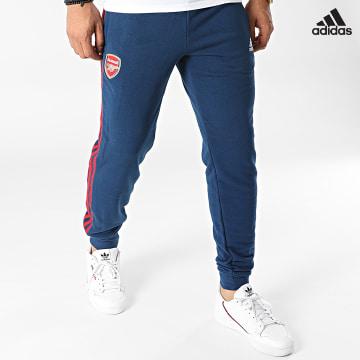 https://laboutiqueofficielle-res.cloudinary.com/image/upload/v1627638668/Desc/Watermark/adidas_performance.svg Adidas Performance - Pantalon Jogging A Bandes Arsenal FC 3 Stripes GR4231 Bleu Marine