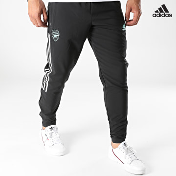https://laboutiqueofficielle-res.cloudinary.com/image/upload/v1627638668/Desc/Watermark/adidas_performance.svg Adidas Performance - Pantalon Jogging A Bandes Arsenal FC GR4134 Noir