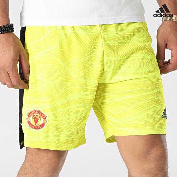 https://laboutiqueofficielle-res.cloudinary.com/image/upload/v1627638668/Desc/Watermark/adidas_performance.svg Adidas Performance - Short De Sport A Bandes Manchester United GM4626 Jaune Noir
