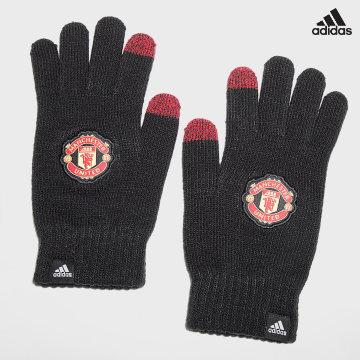 https://laboutiqueofficielle-res.cloudinary.com/image/upload/v1627638668/Desc/Watermark/adidas_performance.svg Adidas Performance - Gants Manchester United GU0119 Noir