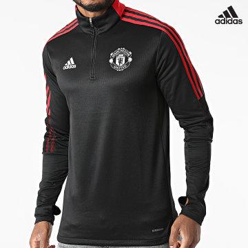 https://laboutiqueofficielle-res.cloudinary.com/image/upload/v1627638668/Desc/Watermark/adidas_performance.svg Adidas Performance - Sweat Col Zippé A Bandes Manchester United GR3801 Noir