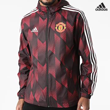 https://laboutiqueofficielle-res.cloudinary.com/image/upload/v1627638668/Desc/Watermark/adidas_performance.svg Adidas Performance - Coupe-Vent Capuche A Bandes Manchester United FC GR3872 Bordeaux