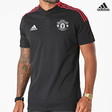 https://laboutiqueofficielle-res.cloudinary.com/image/upload/v1627638668/Desc/Watermark/adidas_performance.svg Adidas Performance - Polo Manches Courtes A Bandes Manchester United FC GR3823 Noir
