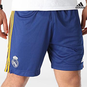 https://laboutiqueofficielle-res.cloudinary.com/image/upload/v1627638668/Desc/Watermark/adidas_performance.svg Adidas Performance - Short Jogging A Bandes Real Madrid GM6787 Bleu Roi