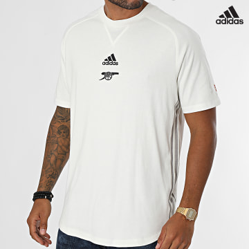 https://laboutiqueofficielle-res.cloudinary.com/image/upload/v1627638668/Desc/Watermark/adidas_performance.svg Adidas Performance - Tee Shirt De Sport A Bandes Arsenal FC GR4215 Ecru