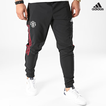 https://laboutiqueofficielle-res.cloudinary.com/image/upload/v1627638668/Desc/Watermark/adidas_performance.svg Adidas Performance - Pantalon Jogging A Bandes Manchester United GR3809 Noir