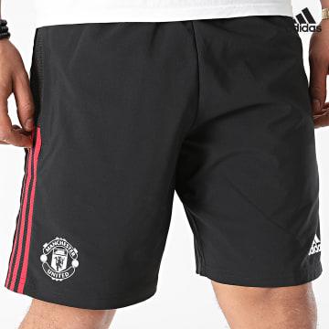 https://laboutiqueofficielle-res.cloudinary.com/image/upload/v1627638668/Desc/Watermark/adidas_performance.svg Adidas Performance - Short Jogging A Bandes Manchester United GR4121 Noir