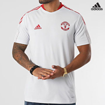 https://laboutiqueofficielle-res.cloudinary.com/image/upload/v1627638668/Desc/Watermark/adidas_performance.svg Adidas Performance - Tee Shirt A Bandes Manchester United GV1573 Gris Clair