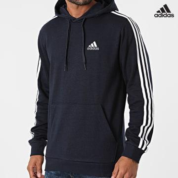 https://laboutiqueofficielle-res.cloudinary.com/image/upload/v1627638668/Desc/Watermark/adidas_performance.svg Adidas Performance - Sweat Capuche A Bandes GK9081 Bleu Marine