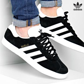 https://laboutiqueofficielle-res.cloudinary.com/image/upload/v1627646526/Desc/Watermark/3adidas_orginal.svg Adidas Originals - Baskets Gazelle BB5476 Core Black White Gold Metallic