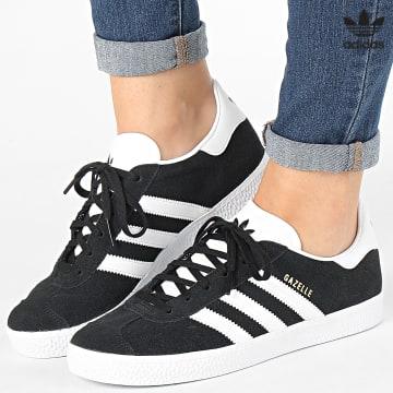 https://laboutiqueofficielle-res.cloudinary.com/image/upload/v1627646526/Desc/Watermark/3adidas_orginal.svg Adidas Originals - Baskets Femme Gazelle BB2502 Core Black White