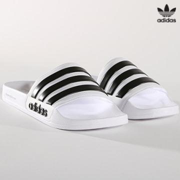 https://laboutiqueofficielle-res.cloudinary.com/image/upload/v1627646526/Desc/Watermark/3adidas_orginal.svg Adidas Originals - Claquettes Adilette Shower AQ1702 Blanc Noir