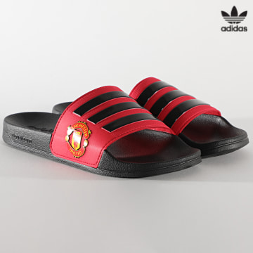 https://laboutiqueofficielle-res.cloudinary.com/image/upload/v1627646526/Desc/Watermark/3adidas_orginal.svg Adidas Originals - Claquettes Adilette Shower Manchester United FW7072 Real Red Core Black