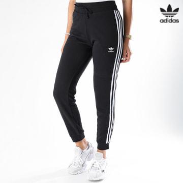https://laboutiqueofficielle-res.cloudinary.com/image/upload/v1627646526/Desc/Watermark/3adidas_orginal.svg Adidas Originals - Pantalon Jogging Slim Femme A Bandes GD2255 Noir