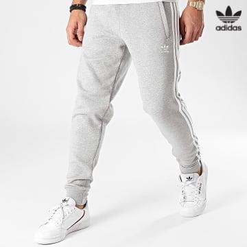 https://laboutiqueofficielle-res.cloudinary.com/image/upload/v1627646526/Desc/Watermark/3adidas_orginal.svg Adidas Originals - Pantalon Jogging A Bandes GN3530 Gris Chiné