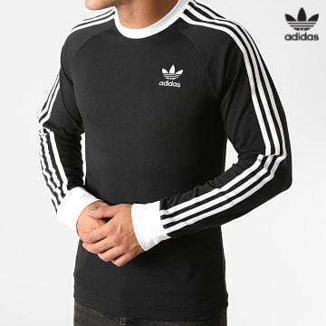 https://laboutiqueofficielle-res.cloudinary.com/image/upload/v1627646526/Desc/Watermark/3adidas_orginal.svg Adidas Originals - Tee Shirt Manches Longues A Bandes 3 Stripes GN3478 Noir