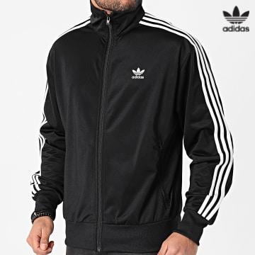 https://laboutiqueofficielle-res.cloudinary.com/image/upload/v1627646526/Desc/Watermark/3adidas_orginal.svg Adidas Originals - Veste Zippée A Bandes Firebird GN3521 Noir
