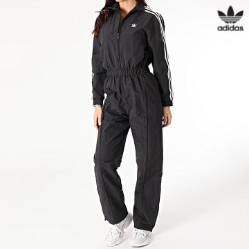 https://laboutiqueofficielle-res.cloudinary.com/image/upload/v1627646526/Desc/Watermark/3adidas_orginal.svg Adidas Originals - Combinaison Femme A Bandes Boiler GN2781 Noir