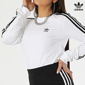 https://laboutiqueofficielle-res.cloudinary.com/image/upload/v1627646526/Desc/Watermark/3adidas_orginal.svg Adidas Originals - Tee Shirt Manches Longues Femme A Bandes Adicolor GT4261 Blanc