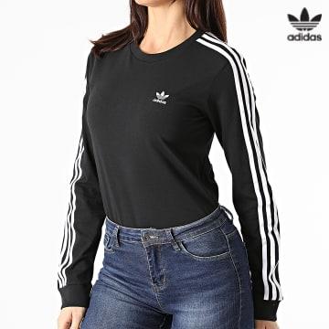 https://laboutiqueofficielle-res.cloudinary.com/image/upload/v1627646526/Desc/Watermark/3adidas_orginal.svg Adidas Originals - Tee Shirt Manches Longues Femme A Bandes 3 Stripes GN2911 Noir