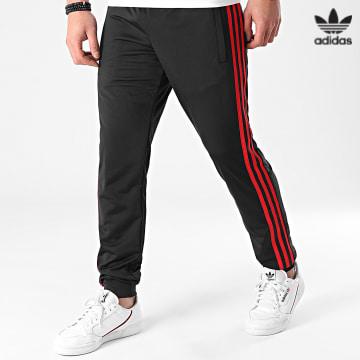 https://laboutiqueofficielle-res.cloudinary.com/image/upload/v1627646526/Desc/Watermark/3adidas_orginal.svg Adidas Originals - Pantalon Jogging A Bandes GN3854 Noir Rouge
