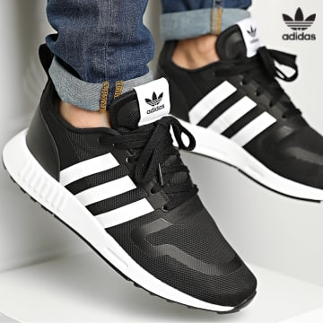 https://laboutiqueofficielle-res.cloudinary.com/image/upload/v1627646526/Desc/Watermark/3adidas_orginal.svg Adidas Originals - Baskets Multix FX5119 Core Black Footwear White