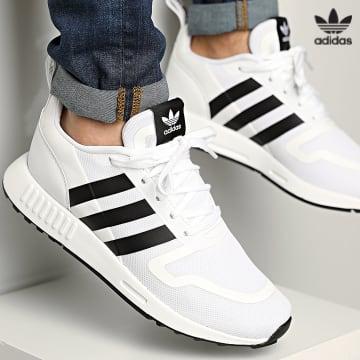 https://laboutiqueofficielle-res.cloudinary.com/image/upload/v1627646526/Desc/Watermark/3adidas_orginal.svg Adidas Originals - Baskets Multix FX5118 Footwear White Core Black