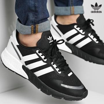https://laboutiqueofficielle-res.cloudinary.com/image/upload/v1627646526/Desc/Watermark/3adidas_orginal.svg Adidas Originals - Baskets ZX 1K Boost FX6515 Core Black Cloud White Black Silver