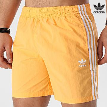 https://laboutiqueofficielle-res.cloudinary.com/image/upload/v1627646526/Desc/Watermark/3adidas_orginal.svg Adidas Originals - Short De Bain A Bandes GN3525 Orange