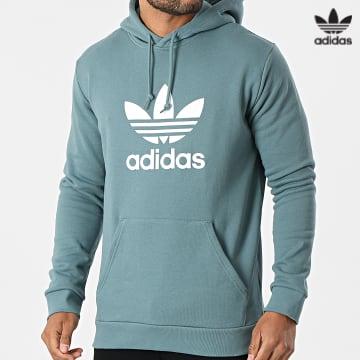 https://laboutiqueofficielle-res.cloudinary.com/image/upload/v1627646526/Desc/Watermark/3adidas_orginal.svg Adidas Originals - Sweat Capuche Trefoil GN3461 Vert