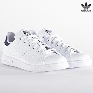 https://laboutiqueofficielle-res.cloudinary.com/image/upload/v1627646526/Desc/Watermark/3adidas_orginal.svg Adidas Originals - Baskets Femme Stan Smith H68621 Cloud White Dark Blue