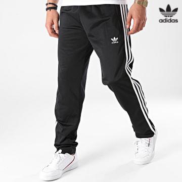 https://laboutiqueofficielle-res.cloudinary.com/image/upload/v1627646526/Desc/Watermark/3adidas_orginal.svg Adidas Originals - Pantalon Jogging A Bandes Firebird GN3517 Noir