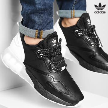 https://laboutiqueofficielle-res.cloudinary.com/image/upload/v1627646526/Desc/Watermark/3adidas_orginal.svg Adidas Originals - Baskets ZX 2K Boost S42835 Core Black Footwear White