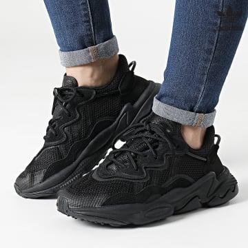 https://laboutiqueofficielle-res.cloudinary.com/image/upload/v1627646526/Desc/Watermark/3adidas_orginal.svg Adidas Originals - Baskets Femme Ozweego EE7775 Core Black True Grey Metallic