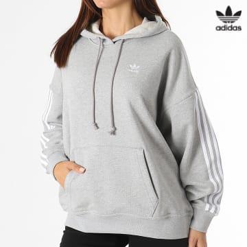 https://laboutiqueofficielle-res.cloudinary.com/image/upload/v1627646526/Desc/Watermark/3adidas_orginal.svg Adidas Originals - Sweat Capuche Femme A Bandes H06776 Gris Chiné