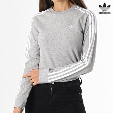 https://laboutiqueofficielle-res.cloudinary.com/image/upload/v1627646526/Desc/Watermark/3adidas_orginal.svg Adidas Originals - Tee Shirt Manches Longues Femme A Bandes H33570 Gris Chiné