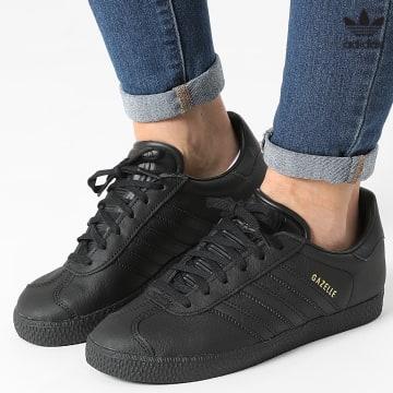 https://laboutiqueofficielle-res.cloudinary.com/image/upload/v1627646526/Desc/Watermark/3adidas_orginal.svg Adidas Originals - Baskets Femme Gazelle BY9146 Core Black