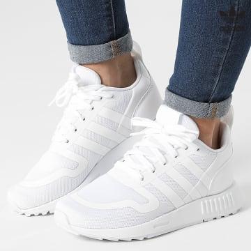 https://laboutiqueofficielle-res.cloudinary.com/image/upload/v1627646526/Desc/Watermark/3adidas_orginal.svg Adidas Originals - Baskets Femme Multix Q47135 Cloud White