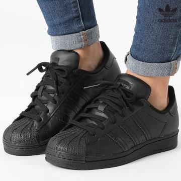 https://laboutiqueofficielle-res.cloudinary.com/image/upload/v1627646526/Desc/Watermark/3adidas_orginal.svg Adidas Originals - Baskets Femme Superstar FU7713 Core Black