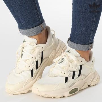 https://laboutiqueofficielle-res.cloudinary.com/image/upload/v1627646526/Desc/Watermark/3adidas_orginal.svg Adidas Originals - Baskets Femme Ozweego H03127 Cream White Core Black Focoli