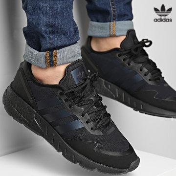 https://laboutiqueofficielle-res.cloudinary.com/image/upload/v1627646526/Desc/Watermark/3adidas_orginal.svg Adidas Originals - Baskets ZX 1K Boost H05335 Core Black Blue Metallic